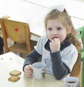 Girl eating chocolate cakes