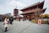 TOKYO - DEC 9: Tourists and sightseers wander around Sensoji Temple in the Asakusa district of Tokyo