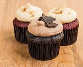 Trio of chocolate and red velvet mini cupcakes with cream cheese frosting
