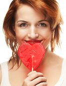 Pretty young woman holding lolly pop. Isolated on white.