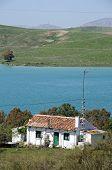 Cottage alongside lake, Ardales, Spain.