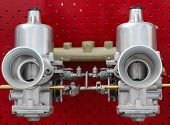 picture of carburetor  - Twin carburetor to suck that fuel in fast.
