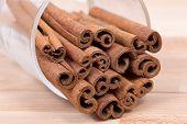 Cinnamon sticks on a wood plateau