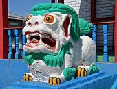 Colorful Statue Of Shishi Lion Guards Entrance To Lamaist Temple Near Ulan Ude, The Capital Of Burya