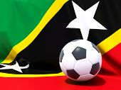 Flag Of Saint Kitts And Nevis With Football In Front Of It