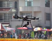 stock photo of drone  - A UAV or drone with a digital camera mounted on it - JPG