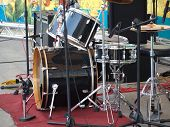 Drum Set And Microphones On A Stage