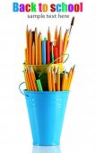 stock photo of non-permanent  - Colorful pencils and other art supplies in pails isolated on white - JPG