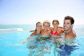 pic of infinity pool  - Happy family enjoying bath time in infinity pool - JPG