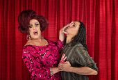 image of transvestites  - Man trying to kiss a transvestite is pushed away - JPG