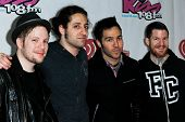 BOSTON-DEC 14: (L-R) Patrick Stump, Joe Trohman, Pete Wentz and Andy Hurley of Fall Out Boy attend KISS 108's Jingle Ball 2013 at TD Garden on December 14, 2013 in Boston.