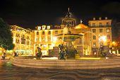 Night-lit fountain in Rossio Square, Lisbon, Portugal