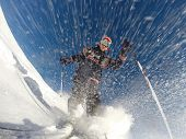 Downhill alpine skiing at high speed on powder snow. Taken with GoPro 3 mounted directly on the ski tip. Model released.