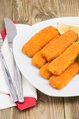 Portion Of Fish Fingers On A Plate