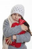 cold sick ill child or kid with hot water bottle.