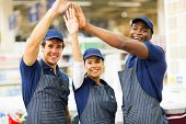 group of cheerful hardware store workers high five