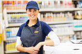 portrait of attractive young female hardware store worker