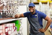 portrait of cheerful african hardware store worker