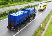 Trucks with toxic waste on the highway. Industry and pollution concept.