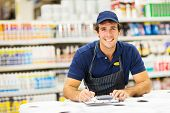 handsome young male hardware store worker