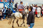 Rider In Traditional Mongolian Deel At Nadaam Horse Race