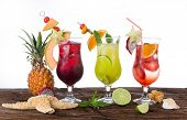 Fresh fruit drinks on wooden table