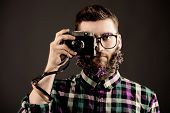 image of greenpeace  - Extravagant young man with a beard of flowers making photographs - JPG