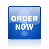 order now blue computer icon on white background