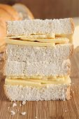 stock photo of home-made bread  - Rustic style hand cut Cheddar cheese sandwich made with home made bread - JPG