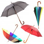 Collage of umbrellas isolated on white