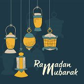 stock photo of ramadan mubarak card  - Beautiful greeting card design with hanging arabic lanterns on blue background for celebration of Ramadan Mubarak - JPG