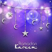 Greeting card design with hanging moon and stars in shiny purple background for holy month of muslim