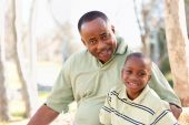 Attractive African American Man And Child Having Fun