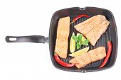 Salmon in pan with pepper.