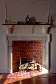 Colonial Style Home Interior With Brick And Marble Fireplace
