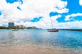 Waikiki shoreline with boat and Diamond Head in Honolulu