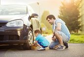 picture of father time  - Young father with his little son washing car - JPG