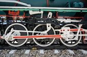 pic of hooters  - Wheels and connecting rod of old steam locomotive on railway - JPG