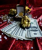 Golden Buddha, golden frog, jewelry and money