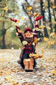 Beautiful Blonde Throwing Leaves In The Air