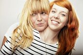 Red And Blond Haired Girls Friend Laughing And Hug