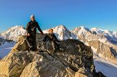 Boy and his father on the summit of Aiguille du Tour in the French Alps