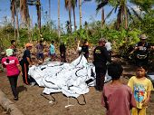 Aid Workers Erecting Emergency Shelter For Victims