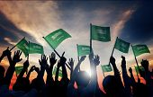 Silhouettes of People Holding Flag of Saudi Arabia
