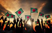 stock photo of bangladesh  - Silhouettes of People Holding Flag of Bangladesh - JPG
