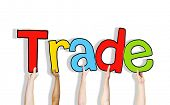 stock photo of bartering  - Diverse Hands Holding the Word Trade - JPG