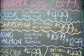 Blackboard specials, fish for sale.