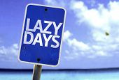 Lazy Days sign with a beach on background
