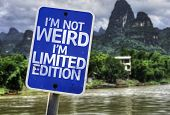 I'm Not Weird Im Limited Edition sign with a forest background