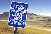 If You're Not Doing What you Love You're Wasting your Time sign with a desert background